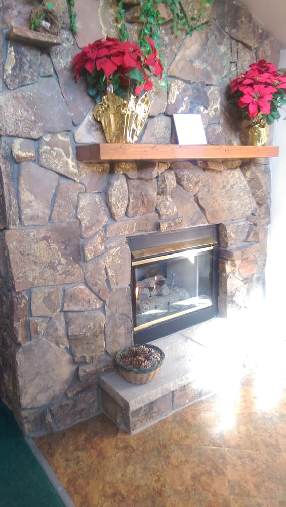 fire place still had christmas decorations in late. Black Bedroom Furniture Sets. Home Design Ideas