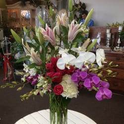 Photo of Creative Flowers - Visalia, CA, United States. Orchids make this bouquet