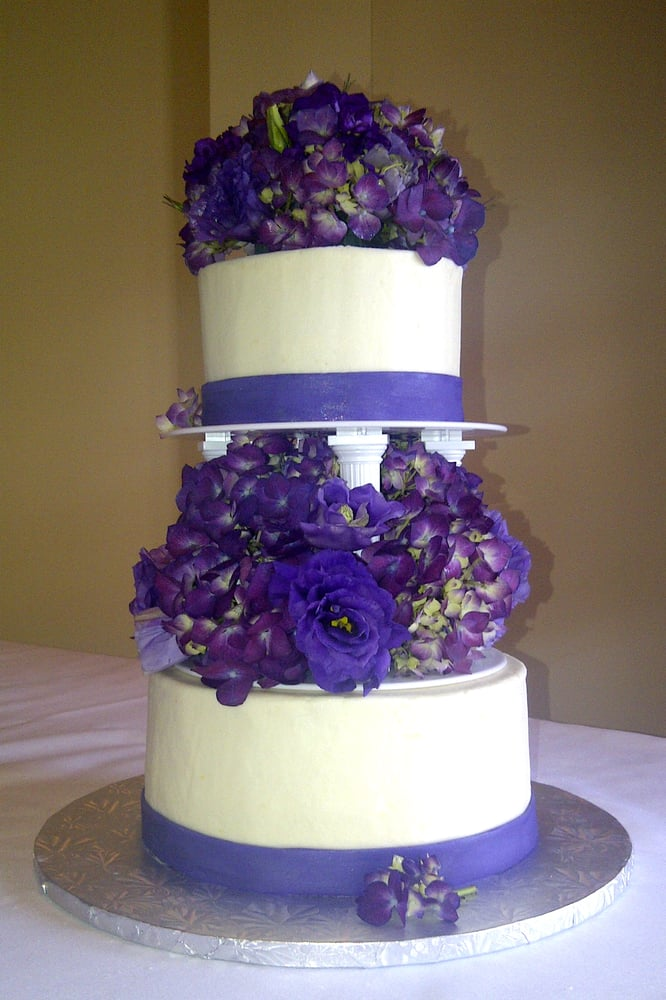 Two Tier Wedding Cake With Columns Purple Fondant Ribbon