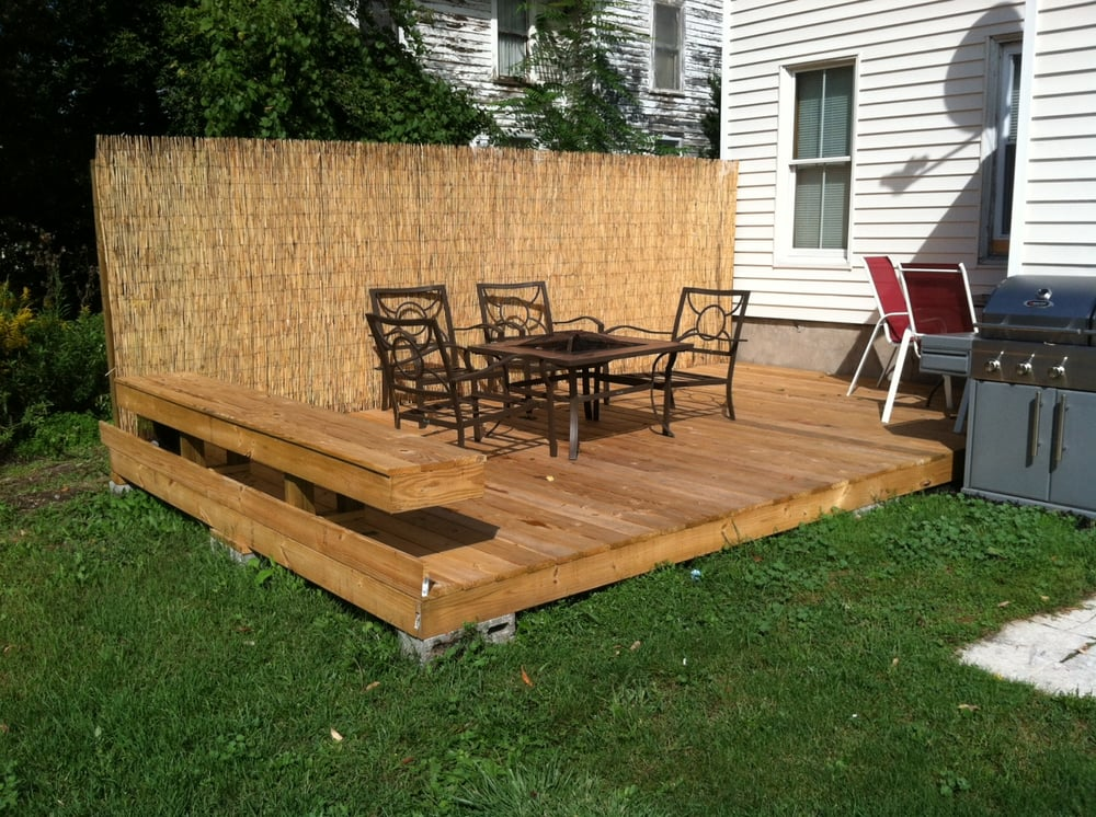 floating deck with custom built bench seating - Yelp