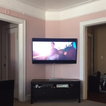 samsung curved tv in living room. photo of anthony\u0027s professional tv mounting service - howard beach, ny, united states. samsung curved tv in living room