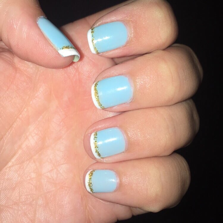 Gel French manicure with a blue base, gold line, and classic white ...