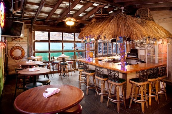 The Tiki Bar With Garage Door That Opens To Fun Patio
