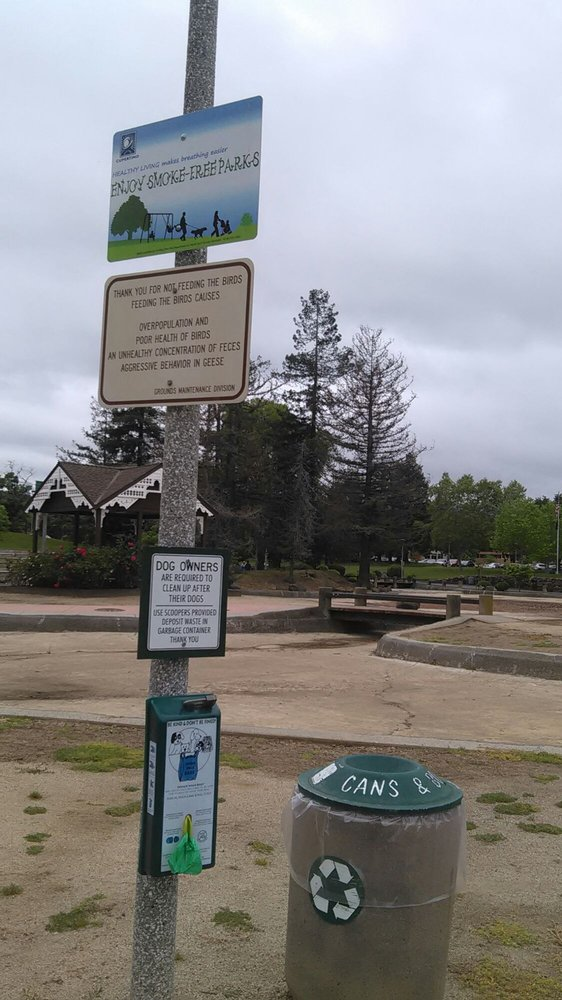 no feeding birds, pick up dog poop signs, with drained pond