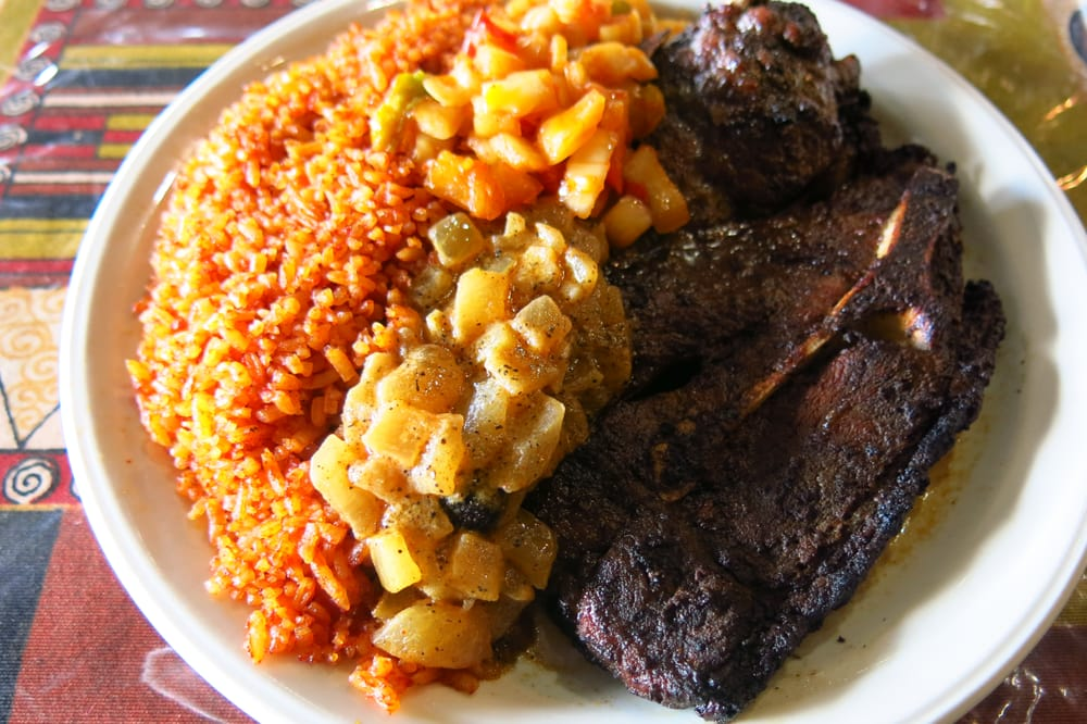 Lamb chops with jollof rice yelp for African cuisine chicago