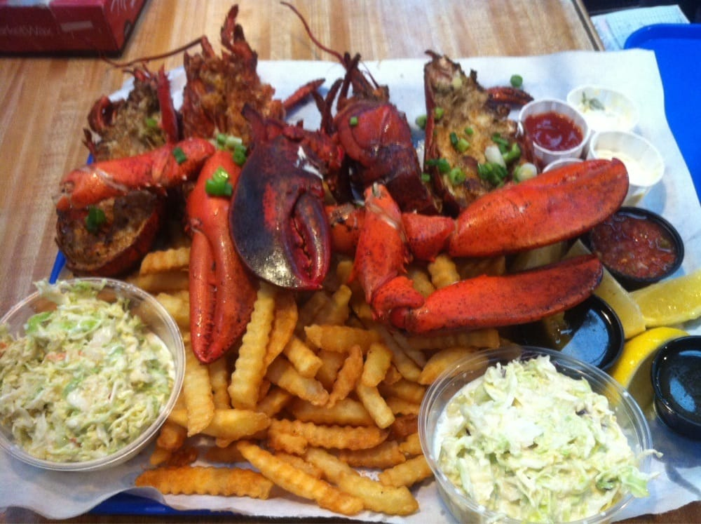 Two maine lobsters with fries and slaw perfection yelp for Long beach fish market