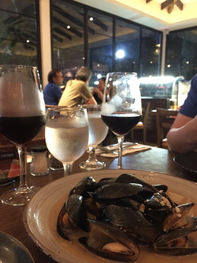 Photo of Canopy Garden Dining u0026 Bar - Singapore Singapore. Mussels and house red & Mussels and house red - Yelp