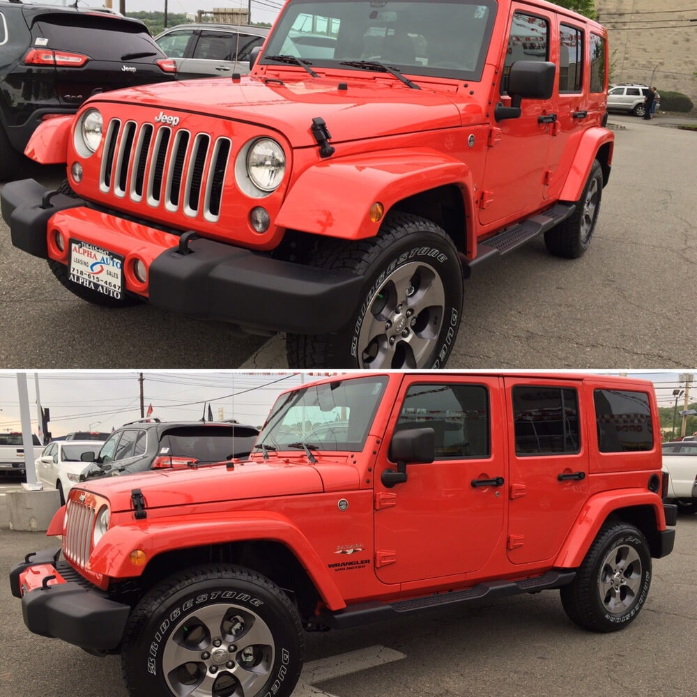 2016 Jeep Wrangler Unlimited Sahara In Firecracker Red.