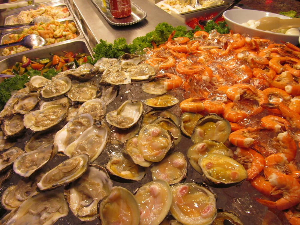Fresh Seafood Raw Oysters Raw Clams And Plump Shrimp On