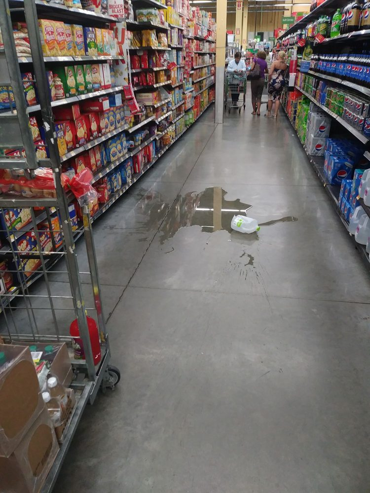 There two night stockers working in the aisle not giving a