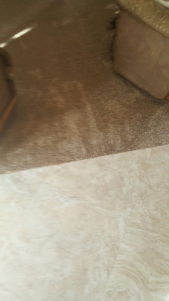 Closeup of tile and carpet transition thick carpet and for 2 thick granite
