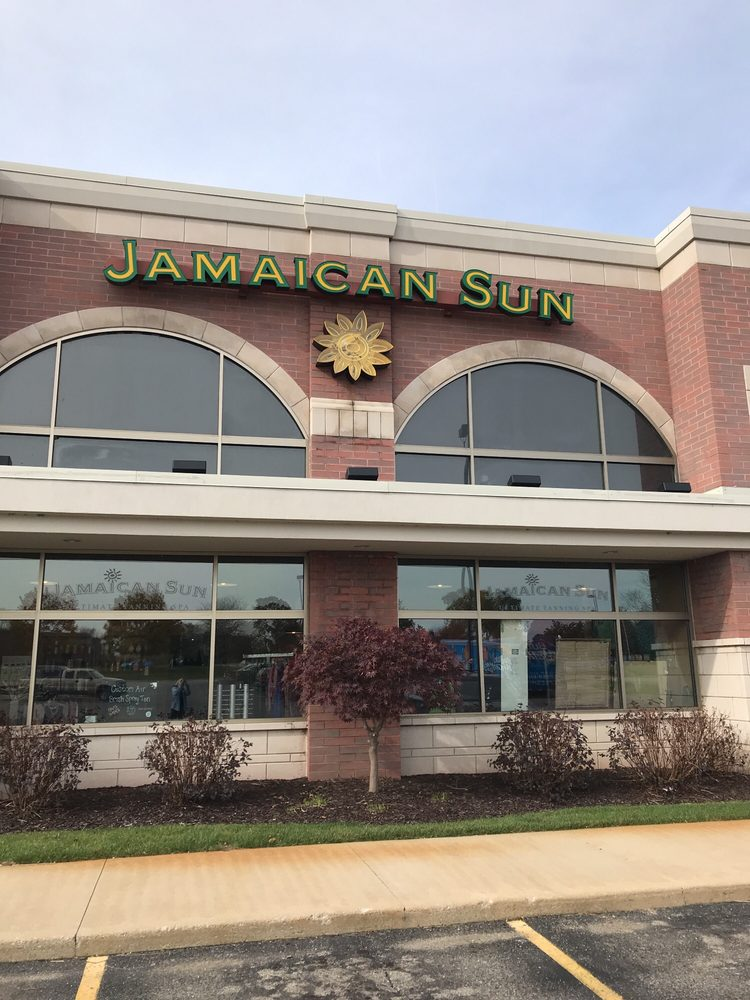 Jamaican Sun & Boutique: 9343 Cherry Valley Ave SE, Caledonia, MI
