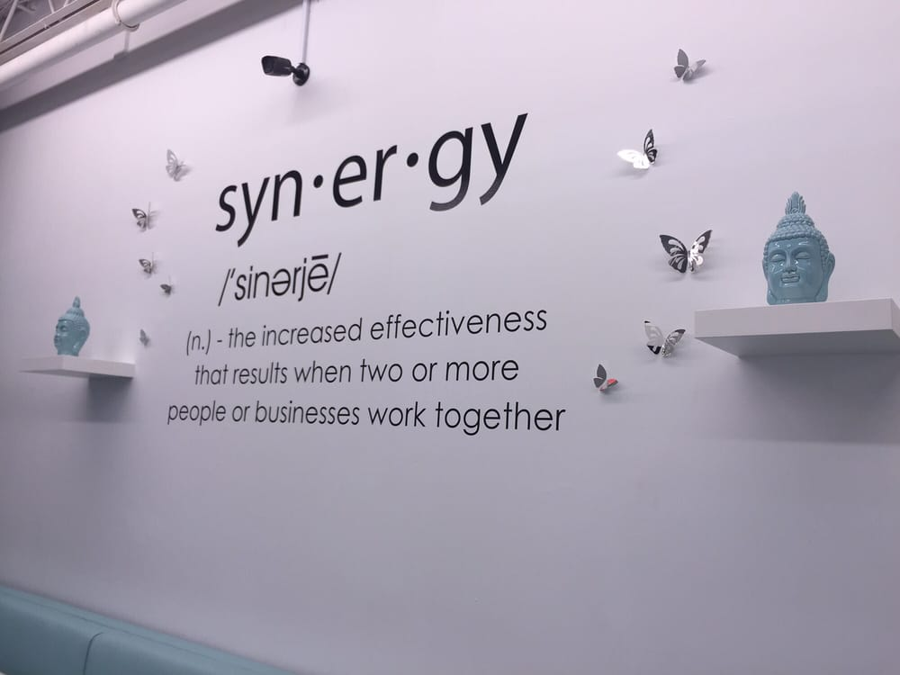 The definition of Synergy displayed in waiting area - Yelp