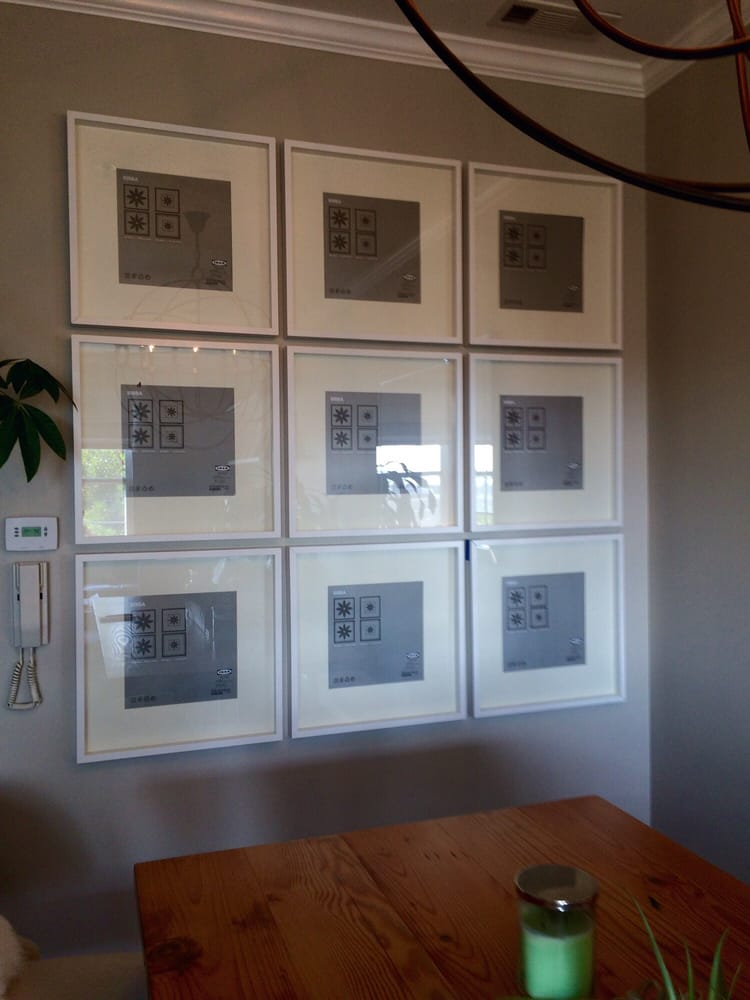 Grid with IKEA Ribba gallery frames. Work by Bill. - Yelp