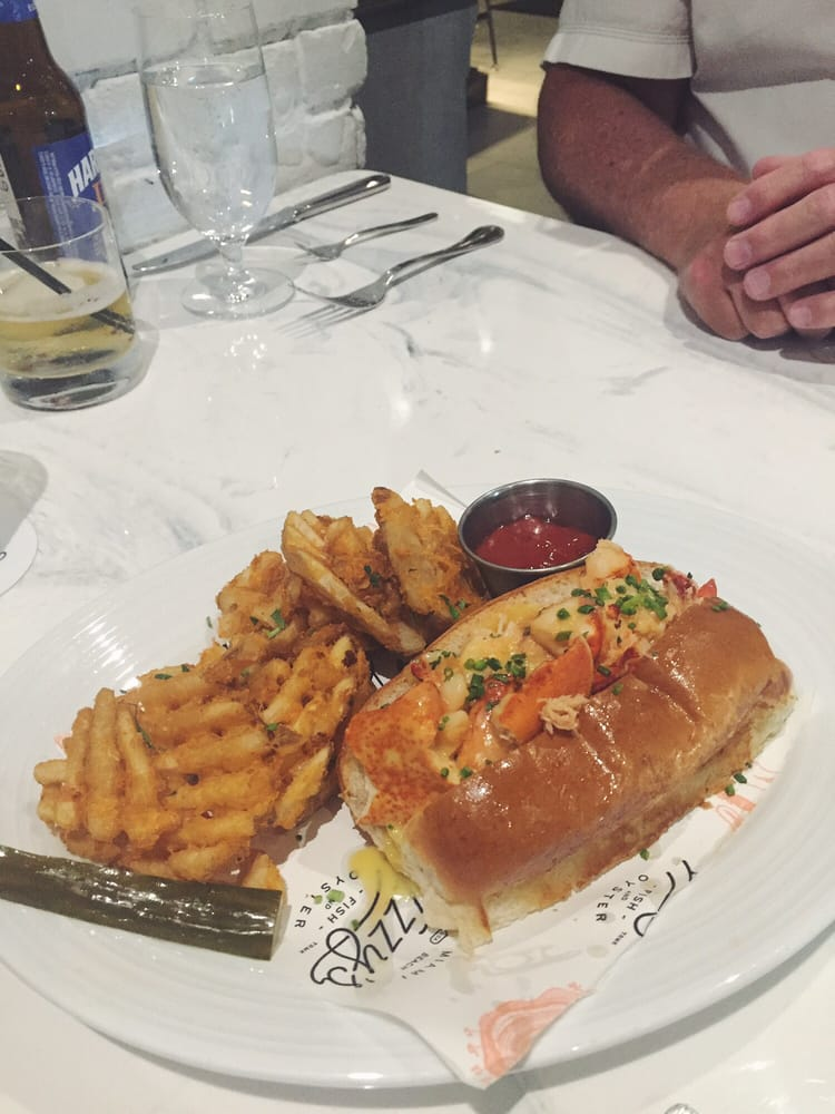 New england lobster roll served warm with lobster butter for Izzys fish and oyster