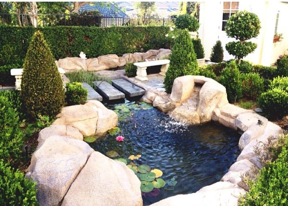 Beautiful custom koi pond renovation and landscape by koi for Custom koi ponds