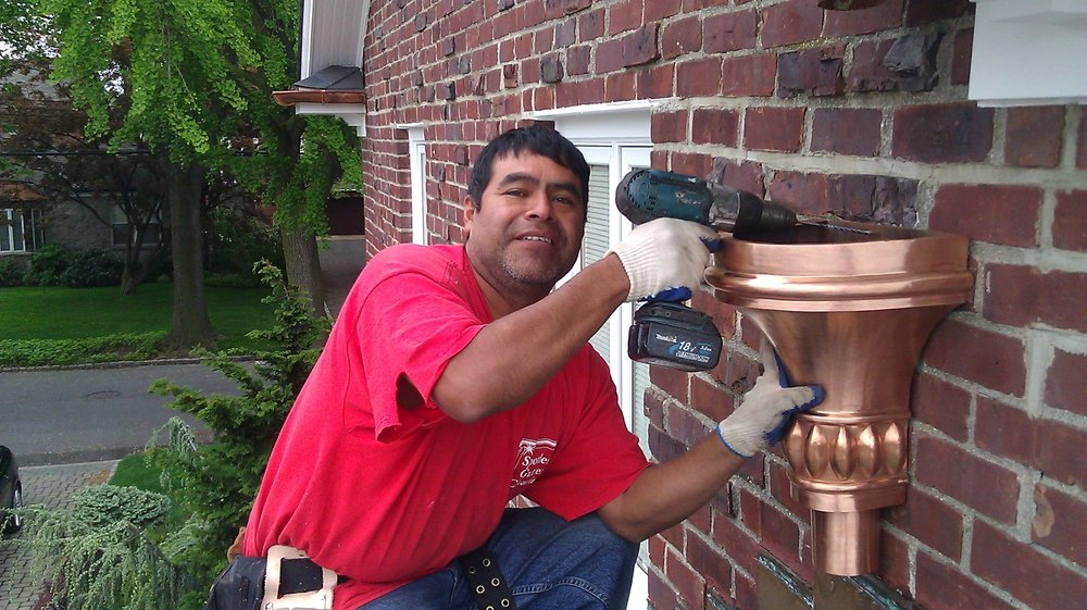 Spotless Gutter Cleaning & Repair: 205 Elm Pl, Mineola, NY