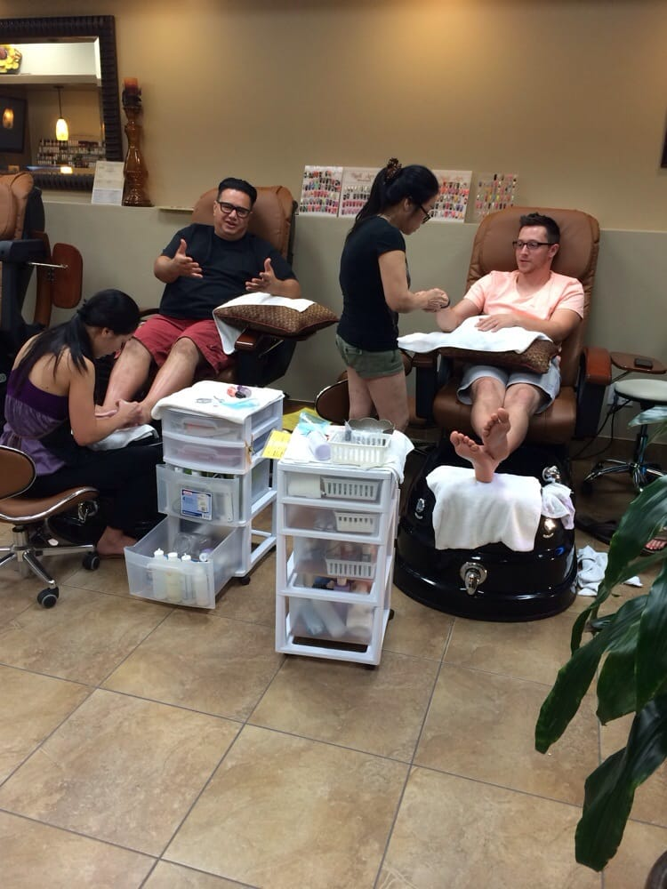My dad and boyfriend getting their hands and feet done! - Yelp