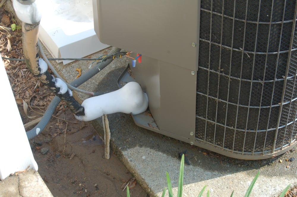Beat Up AC Unit With Ice on the Piping from Freon Leak - Yelp