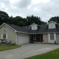 Southern homes realty building services 11212 n may for Southern living phone number