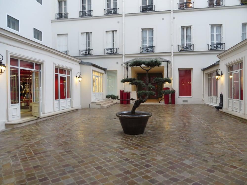 Photo of Comme des Garçons - Paris, France. Walkway to the retail boutique.