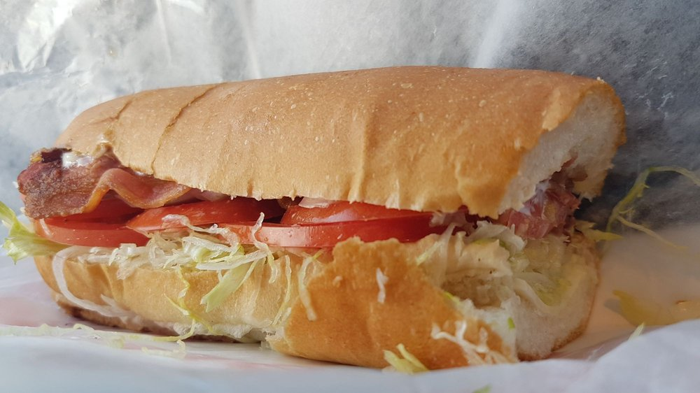 submarine sandwich and subs Combine meatballs and sauce and pile into sub rolls, 4 meatballs per sub top with shredded cheese and place under subs under broiler to melt cheese top with shredded basil or arugula and serve.