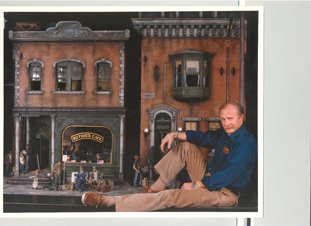 Michael Garman In Front Of City Life A Street Scene In