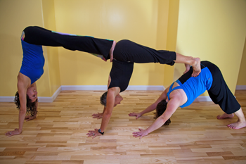 partner yoga play with ananda instructors justine in box