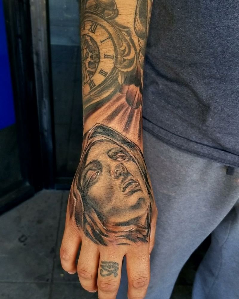 Laying in some details with these Virgen Mary tattoo on the hand. - Yelp