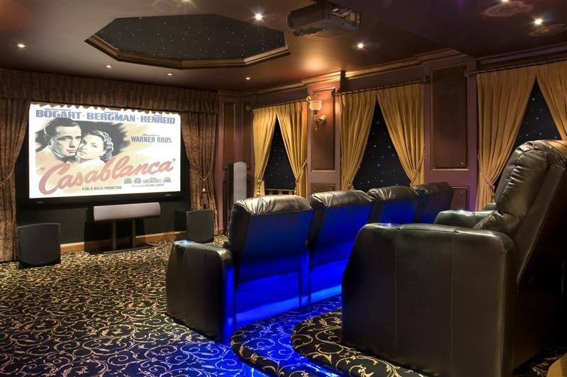 Cozy movie room yelp for Decorating den interiors