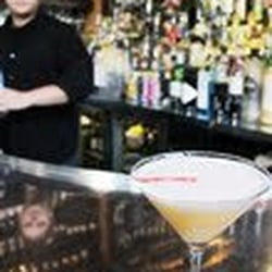 Photo of Aquitaine - Boston, MA, United States. A Tangerine Pisco Sour with