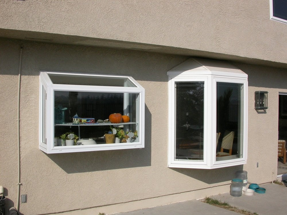 Replaces alum windows and replaced windows with vinyl dual for Vinyl bay window