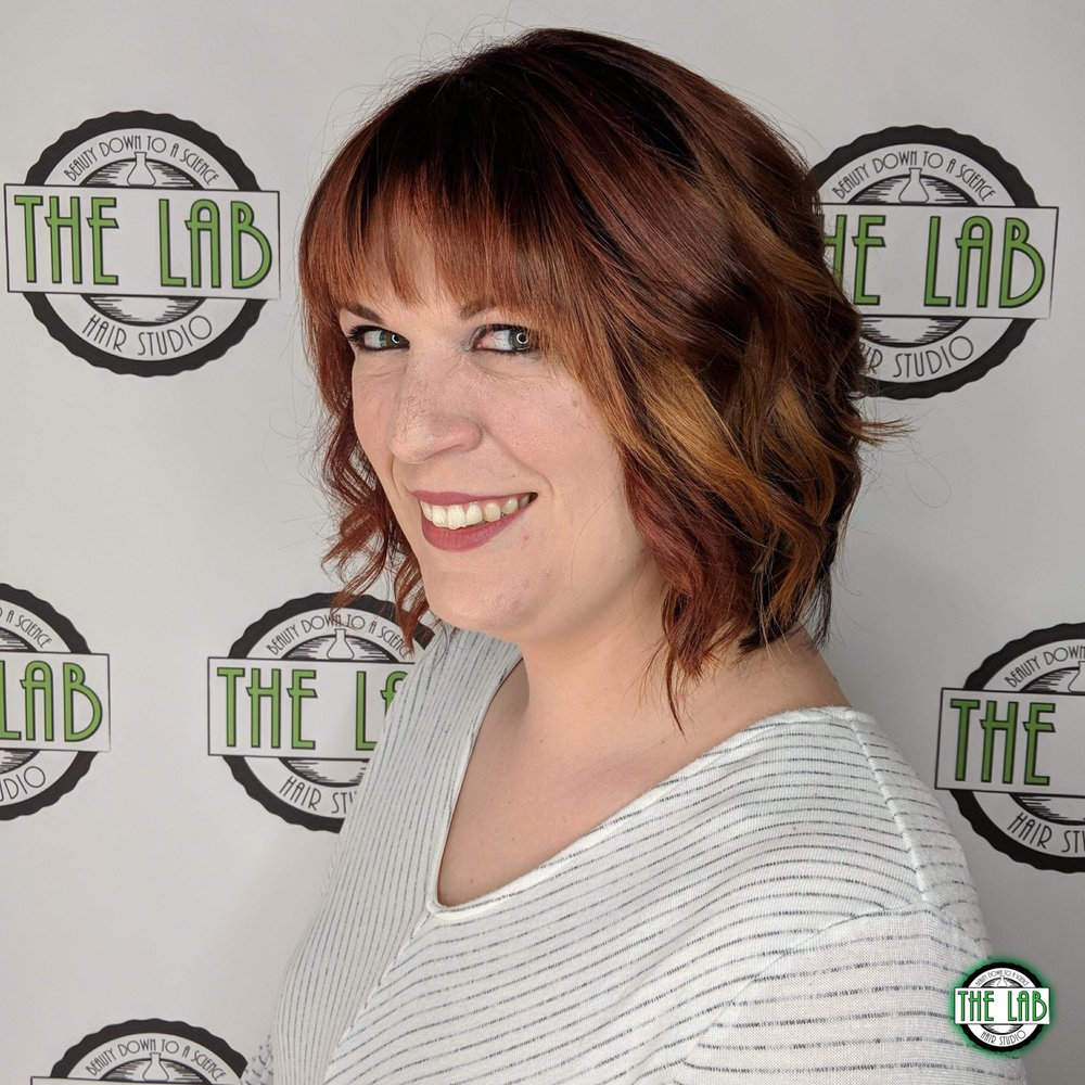 Womans Haircut With Copper Orange And Red Color Melt Compliments