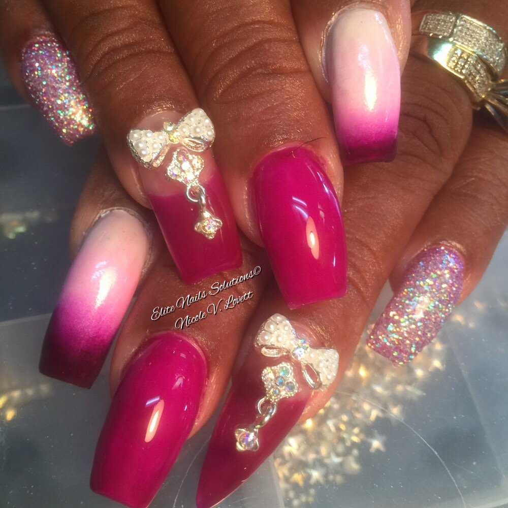 Long acrylic square shape with a pointy nail accessorized with 3D ...