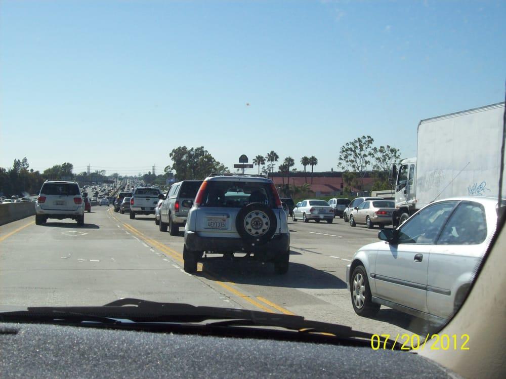 This vehicle illegally left the carpool lane!!! Damn  - Yelp