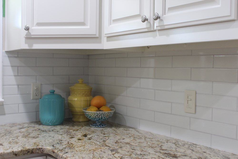 2 X 10 Crackled Subway Tile Laid On Brick Pattern With White Grout