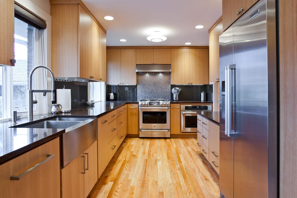 Contemporary kitchen cabinets built using rift cut white for Modern kitchen cabinet finishes