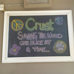 Crust - Cleveland, OH, United States. Awesome sign. Except that eating pizza won't save the world. But if you tell yourself it will, maybe it tastes better?