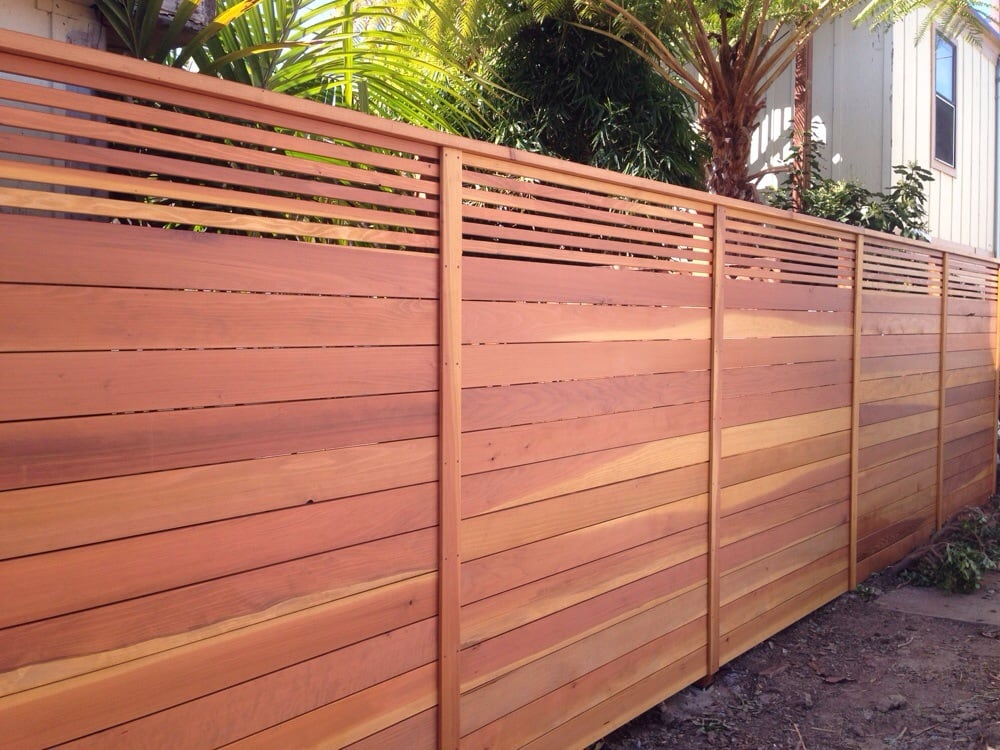 Custom horizontal fence with picket accent top stained Wood valley designs