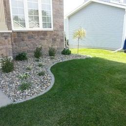 Excel lawns landscape get quote 15 photos snow for Landscaping rocks des moines