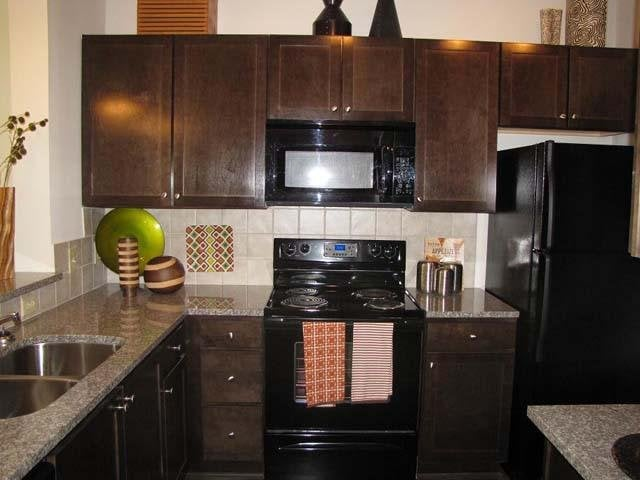 black appliances granite countertops in all kitchens yelp. Black Bedroom Furniture Sets. Home Design Ideas
