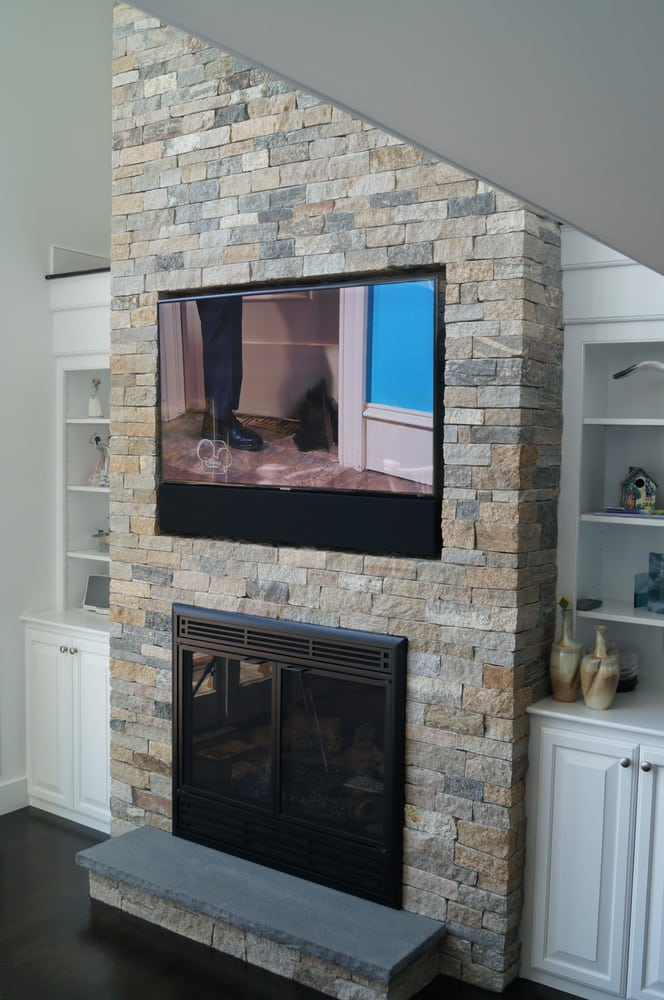 60 Tv Recessed Above A Stone Fireplace In Chatham Thanks To