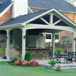 Cutting edge landscape contractors get quote builders for Outdoor kitchen roof structures