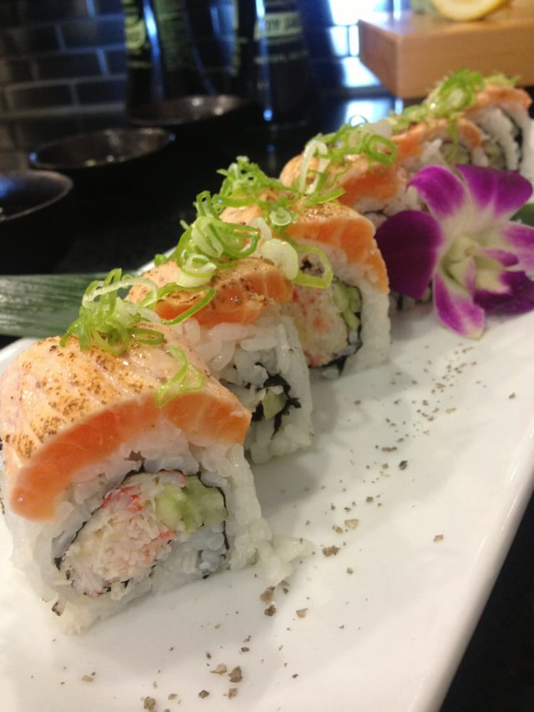 Seared salmon over snow crab roll. - Yelp