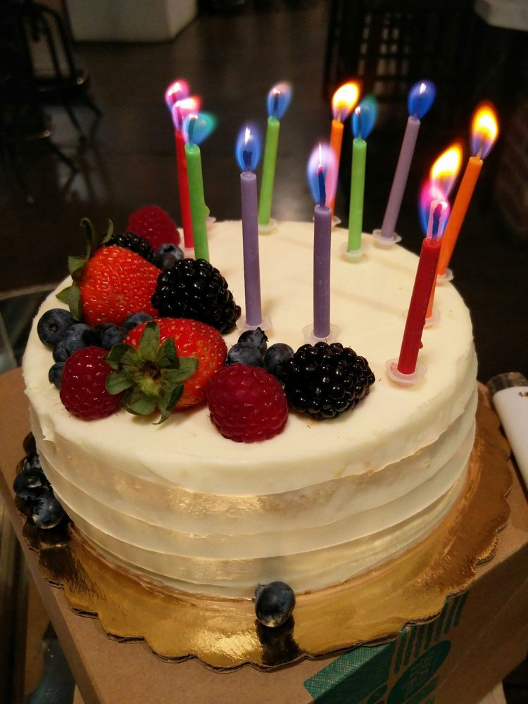 fruit chantilly cake with multicolored candles