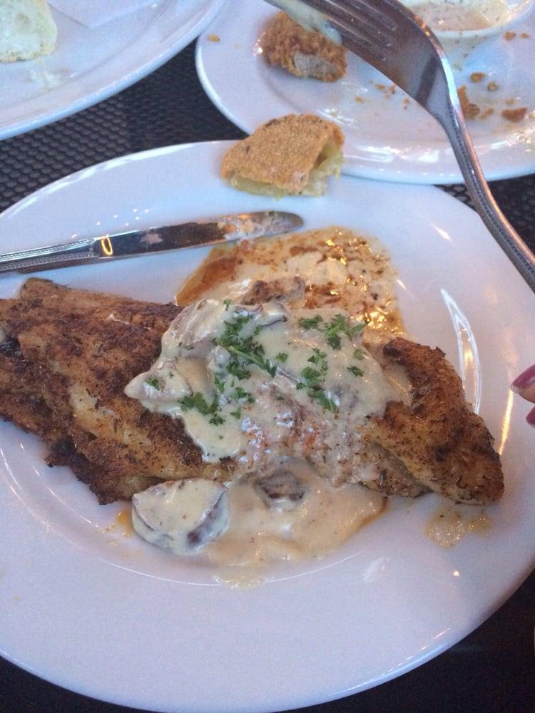 Blackened catfish with andouille cream sauce. - Yelp