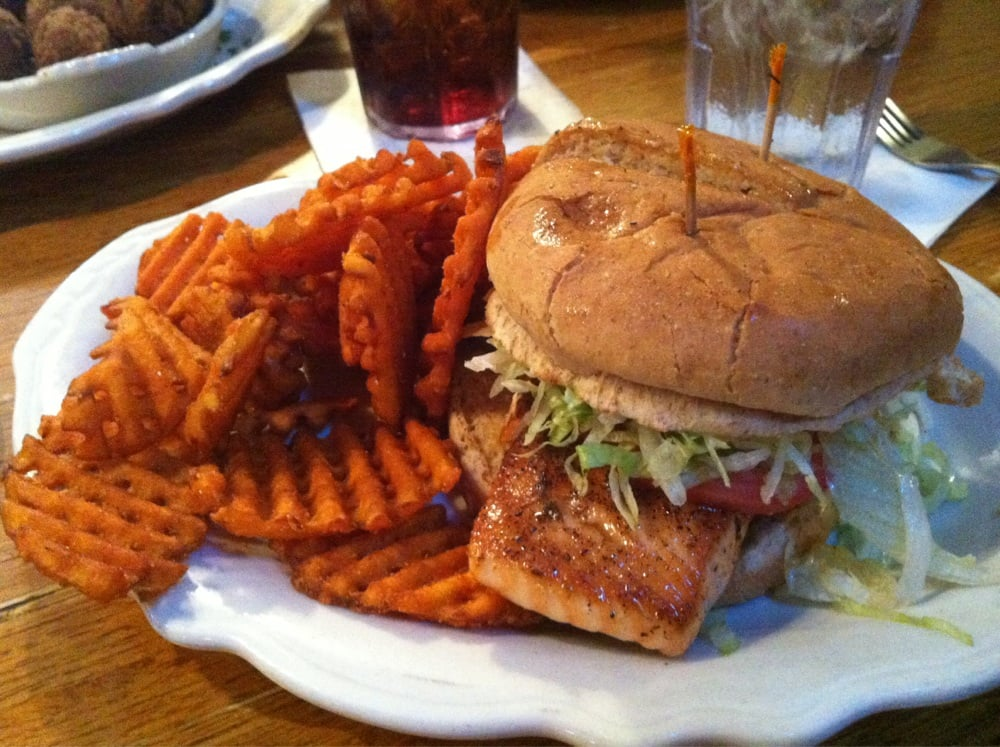 ... LA, United States. Blackened Salmon Sandwich with sweet potato fries