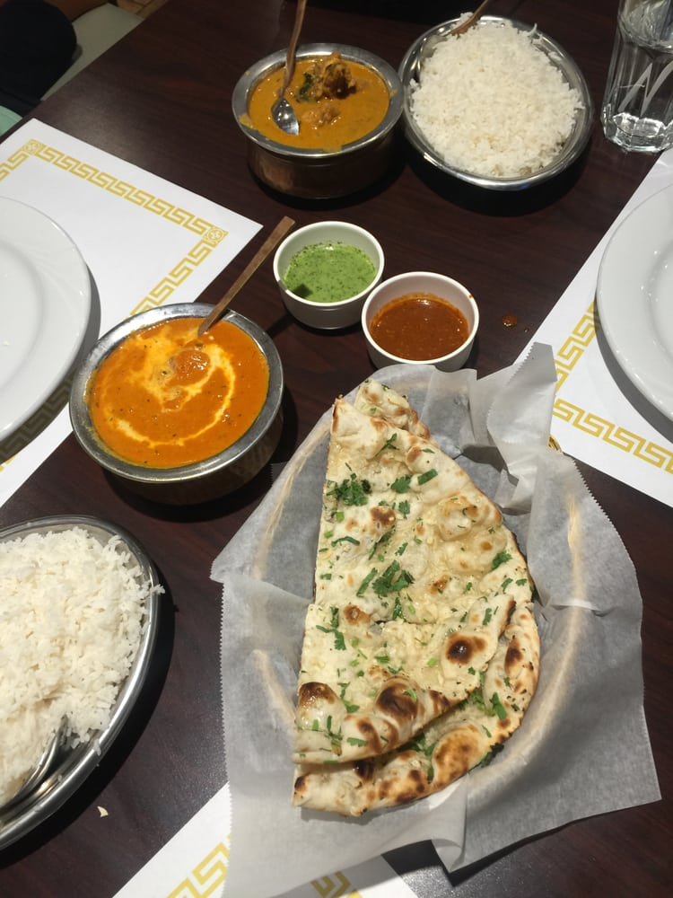 Garlic naan shown with chicken tikka masala the entree for Aroma cuisine of india