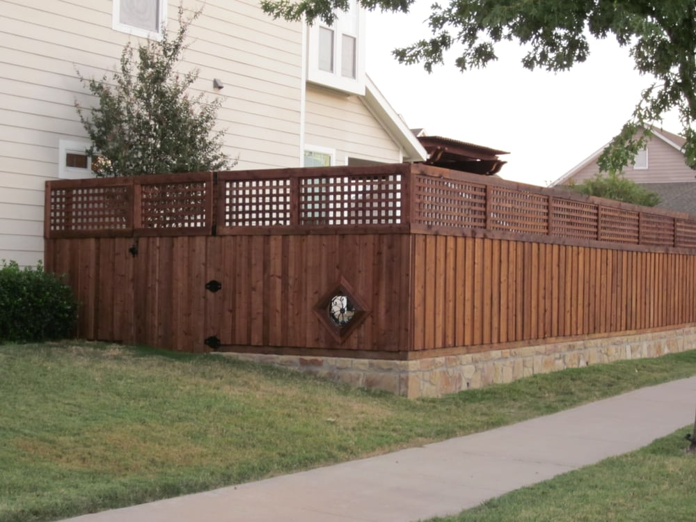 Board on fence with lattice top and retaining