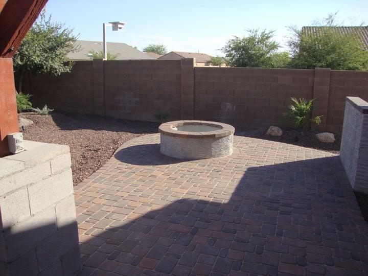 Arizona landscape design with wood burning firepit set in for Landscaping rock queen creek az